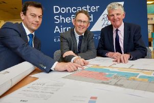 Aviation minister Paul Maynard (centre) at Doncaster Sheffield Airport on Thursday as 10m expansion plans for the terminal were announced. Pictured with Robert Hough (right), Chairman of DSA. Picture: Shaun Flannery