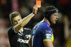 welcome back: Warrington Wolves' Chris Hill is sent off by referee Chris Kendall after just 22 minutes for a tackle on Wigan Warriors' Sam Powell during the opening night of Super League at the DW Stadium. Report: Page 22.' Picture: Martin Rickett/PA
