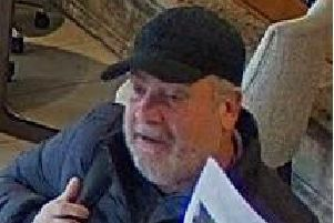 The man is described as white, in his 50s, with a grey beard and short hair.