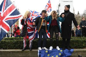 Brexiteers stand on the EU Flag, ahead of the UK leaving the European Union at 11pm on Friday. Pic: PA