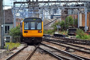 A Pacer train leaves Leeds station.