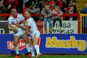 Greg Minkin, left, celebrates with Adam Quinlan after scoring on his Hull KR debut