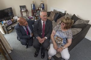 Leeds Central MP Hilary Benn officially opened a new �4.5 million affordable housing scheme at Brown Lane East, Holbeck, which includes 18 two-bedroom flats and 24 three and four bedroom houses for affordable rent and shared ownership. Pictured Ali Akbor, Chief Executive of Unity Homes and Enterprise, and Hillary Benn, MP, chatting with home owner Margaret Mitchell.