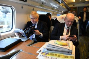 Prime Minister Boris Johnson, sitting with his Director of Communications, Lee Cain (right). Photo: PA