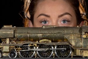 Becky Brigham, an auction room administrator, with a working electric model of the Flying Scotsman made of brass. Pictures: Charlotte Graham