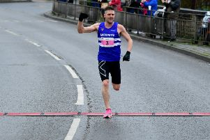 Morpeth HArriers' Chris Parr crosses the finish line to win the Dewsbury 10K.