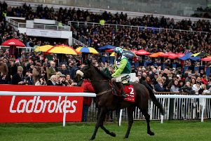Sam Twiston-Davies parades Clan Des Obeaux past the packed Kempton stands after winning a second successive King George VI Chase.