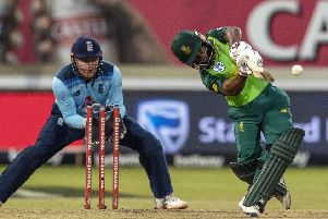 South Africa's batsman Temba Bavuma, right, plays a shot as England's wicketkeepr Jonny Bairstow watches on.