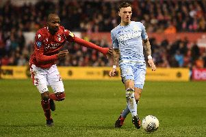 Ben White passes the pull under pressure from Samba Sow in Leeds United's 2-0 defeat at Nottingham Forest