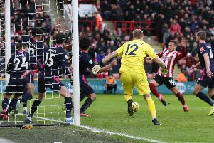 Billy Sharp of Sheffield Utd scores the opening goal against Bournemouth.