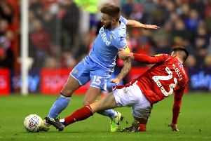 Got him: Nottingham Forest's Joe Lolley tackles Leeds United's Stuart Dallas.