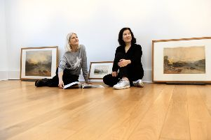 Curators Karen Southworth (left) and  May Catt sorting out some paintings by JMW Turner  for the new exhibition  Northern Exposure  at the Mercer Gallery in Harrogate.