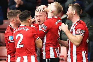 Sheffield United's John Lundstram (centre) celebrates scoring his side's winner against Bournemouth. How many Blades make our Team of the Week? (Picture: PA)