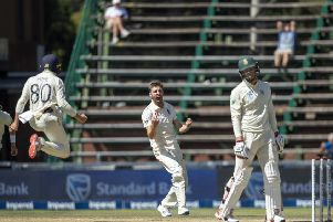 England's Mark Wood celebrates after dismissing South Africa's Rassie van der Dussen for 98 on day four of the fourthTest at the Wanderers.  Picture: AP/Themba Hadebe.