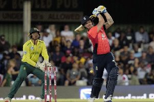 Whack: Jason Roy, right, plays a shot during England's opening T20 international with South Africa, a match they lost by a single run in East London. (Picture: AP/Michael Sheehan)