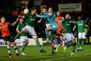 Luton keeper Simon Sluga punches clear as Wednesday look for an equaliser. (Picture: Steve Ellis)