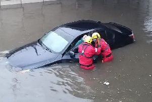 Firefighters risk their lvies to rescue a stranded motorist during Storm Ciara.