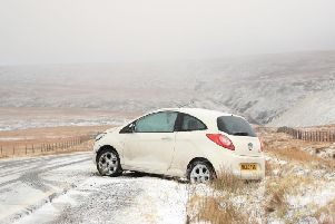 A car trapped at Snake Pass in Derbyshire as Storm Dennis heads north this weekend. Picture: Danny Lawson/PA
