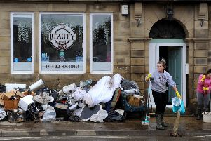 Flooding aftermath after Storm Ciara on Tuesday. Staff at the Beauty Bank clear up after the flood devastation.