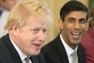 Prime Minister Boris Johnson speaks during his first Cabinet meeting flanked by his new Chancellor of the Exchequer Rishi Sunak. Pic: Getty