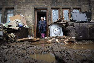 This photo by The Yorkshire Post's Simon Hulme of Mytholmroyd flooding victim Rita Gill has come to epitomise the devastation caused by Storm Ciara.