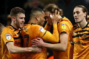 Thriller: Hull City's Tom Eaves, centre right, celebrates scoring his side's fourth goal of the game with team-mate Josh Magennis.