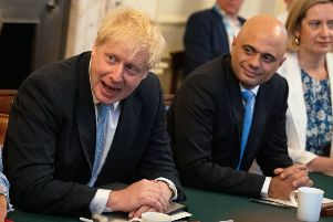 Sajid Javid (right) with Prime Minister Boris Johnson at a Cabinet meeting at Downing Street in London last summer. Picture: Aaron Chown/PA Wire