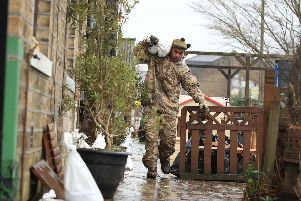 A soldier from The Highlanders, 4th Battalion, the Royal Regiment of Scotland in Mytholmroyd assisting with flood defences, in the Upper Calder Valley in West Yorkshire ahead of Storm Dennis. Picture: Danny Lawson/PA Wire