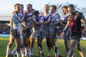 Wakefield's Matty Ashurst celebrates his try in the victory over Warrington. (Picture: Tony Johnson)