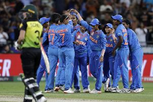 Victory: The Indian team celebrate their win over Australia in the first game of the Women's T20 World Cup in Sydney. Picture: AP Photo/Rick Rycroft