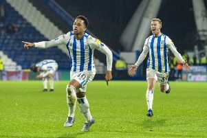 Chris Willock is chased by team-mate Lewis O'Brien as he celebrates scoring Huddersfield's opening goal in their 2-1 win against Bristol City. 'Picture: Bruce Rollinson.