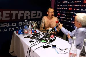 NAKED TRUTH: Mark Williams - as promised - attends his post-match press conference (almost) naked. Picture: PA.