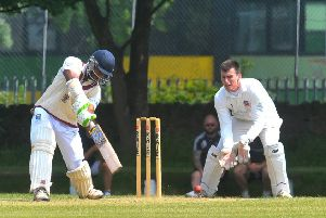 BIG HITTER:  Morley's Sangeeth Coora hits out against Pudsey Congs in Saturday's Bradford League Championship One clash - the hosts winning by four runs. Picture: Steve Riding.