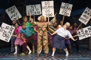 Motormouth Maybelle and Tracy Turnblad lead the protest for equal rights.