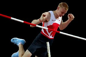 High flier: South Yorkshire pole vaulter Adam Hague competing at the Commonwealth Games where he finished fourth. (Picture: PA)