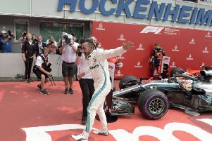 CATCH ME IF YOU CAN: Lewis Hamilton celebrates after winning the German Formula One Grand Prix at the Hockenheimring racetrack in Hockenheim. Picture: AP/Jens Meyer