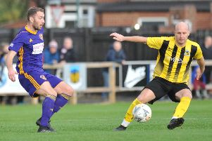Action from the FA Vase clash between Hebburn Town (yellow and black) and City of Liverpool, which was marred by violence after the game.