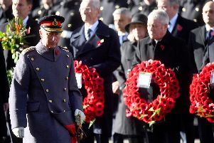 The Prince of Wales lays a wreath during the remembrance service at the Cenotaph memorial in Whitehall, central London, on the 100th anniversary of the signing of the Armistice which marked the end of the First World War.