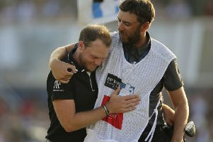end game: England's Danny Willett hugs his caddy after winning the DP World Tour Championship golf tournament in Dubai.  Picture: AP/Kamran Jebreili.