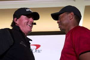 Phil Mickelson, left, and Tiger Woods face off during a news conference at Shadow Creek Golf Course in North Las Vegas. (Steve Marcus/Las Vegas Sun via AP)