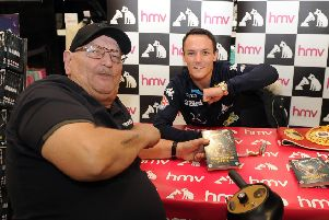 Josh Warrington signs copies of his DVD Fighting for a City at HMV Leeds..Pictured with first in the queue Don Fletcher 26th November 2018 ..Picture by Simon Hulme