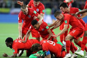 England's players dive on Jordan Pickford after Eric Dier's penalty secured a World Cup win over Colombia. Picture: PA