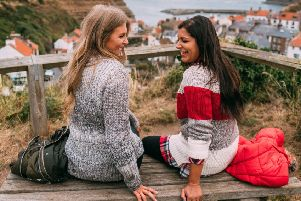 Sinead Crowe, left, of LoveStyleMindfulness wears Seahouse knit, �79.95; Bonnie Rahkit, aka The Style Traveller, wears Padstow knit, �99.95. All at Barbour.com.