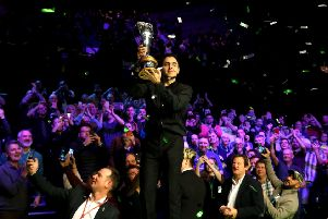 Ronnie O'Sullivan with the trophy after winning the Betway UK Championship at The York Barbican.