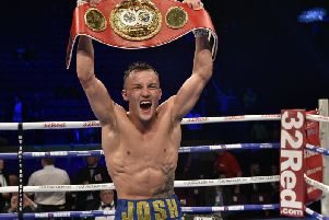 Josh Warrington celebrates in Manchester.
