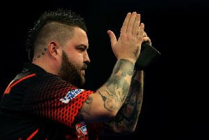 Michael Smith after winning his third round match during  the William Hill World Darts Championships at Alexandra Palace