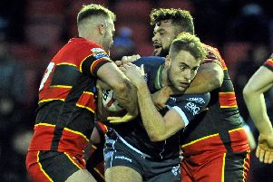 Dewsbury's Tom Garratt and Jordan Andrade combine to stop Featherstone Rovers's Daniel Waite-Pullan in their Yorkshire Cup clash. Picture Tony Johnson.
