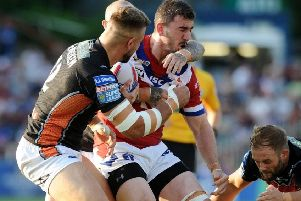 Adam Walker playing for Wakefield against Castleford. Picture: Jonathan Gawthorpe.