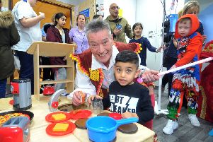 Panto king Billy Pearce with Raheem Mehmood, 3, on the childrens ward at  the Bradford Royal Infirmary. The cast of Aladdin at the Alhambra took a break from their performances to visit the Children and Young Persons Unit at the BRI. Picture Tony Johnson.