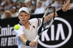 Going out: Britain's Kyle Edmund makes a backhand return to Tomas Berdych. Picture: AP Photo/Andy Brownbill